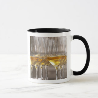 two rows of wine tasting glasses with lucious mug
