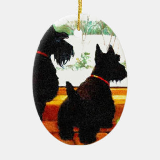 Two Scottie Dogs Waiting for Santa Claus Ceramic Oval Decoration