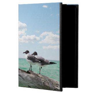 Two seagulls sitting on a dead tree sticking out iPad air cases