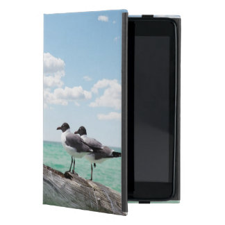 Two seagulls sitting on a dead tree sticking out iPad mini cover