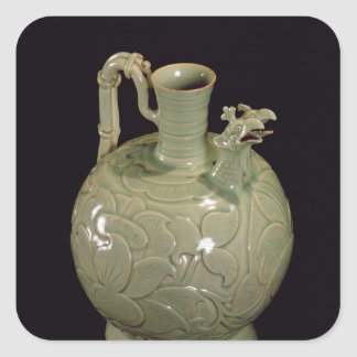 Two spouted jug with a leaf design square sticker