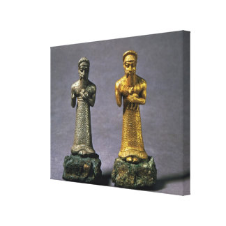 Two statuettes of men carrying offerings of goats, canvas print
