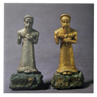 Two statuettes of men carrying offerings of goats, large square tile