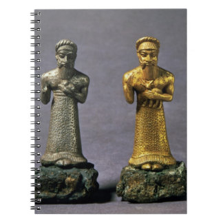 Two statuettes of men carrying offerings of goats, notebook