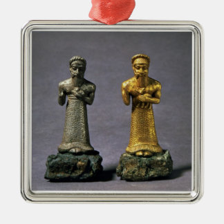 Two statuettes of men carrying offerings of goats, Silver-Colored square decoration
