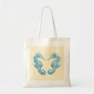 Two teal seahorses beach bag