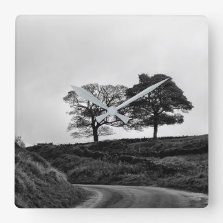 Two trees in black and white wall clock