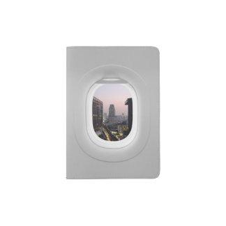 Two views window plane, city and landscape passport holder