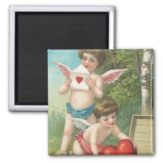 Two Vintage Cupids Delivering Hearts. Square Magnet