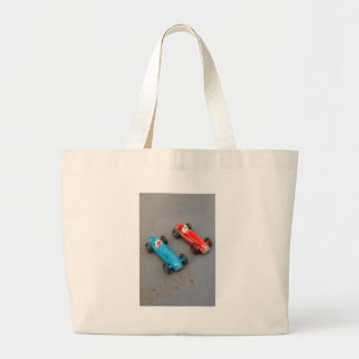 Two vintage toy cars large tote bag