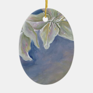 two white lilies on blue christmas ornament