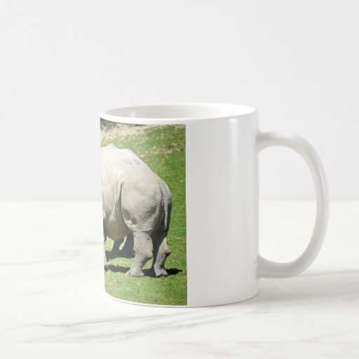 Two white rhinoceros in grass coffee mugs