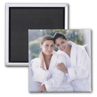 Two woman wearing bath robes magnet