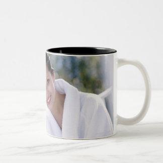 Two woman wearing bath robes Two-Tone coffee mug