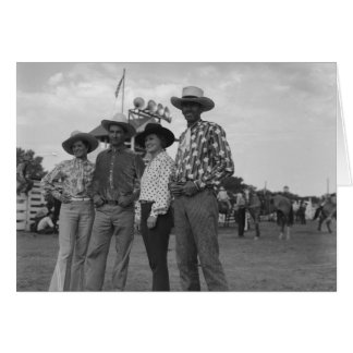 Two women and two men at a rodeo. card