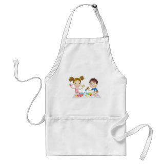 two young children playing with paints aprons