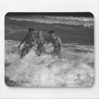 Two young men and woman playing in wave B&W Mouse Mat