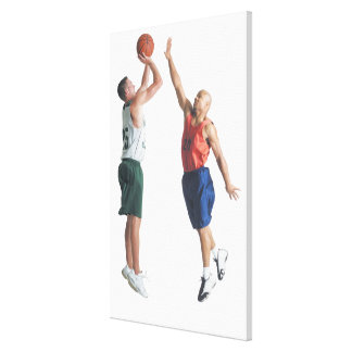 two young men dressed in opposing team canvas print