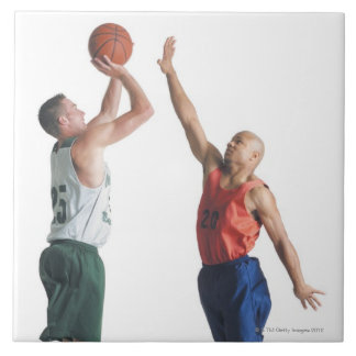 two young men dressed in opposing team large square tile