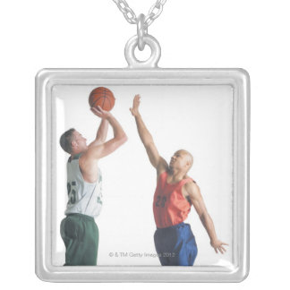 two young men dressed in opposing team silver plated necklace