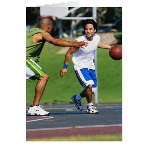 Two young men playing basketball cards