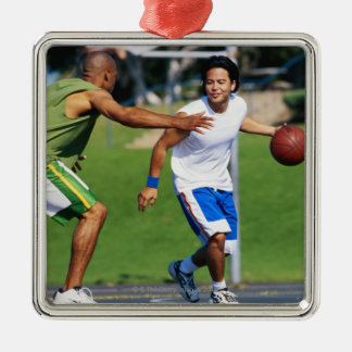 Two young men playing basketball Silver-Colored square decoration