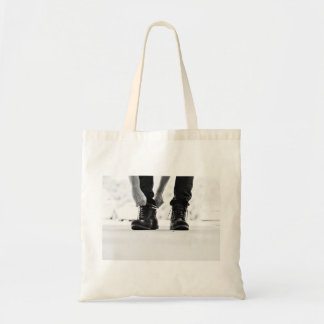 Tying the boots budget tote bag