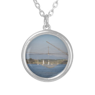 Typical italian fishing net along the river round pendant necklace