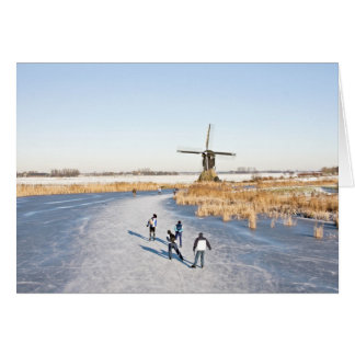 Typically dutch: ice skating on a frozen lake card