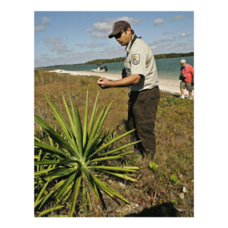 U S Fish and Wildlife employee looking at yucca p Flyer