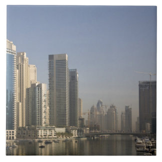 UAE, Dubai. Marina towers with boats at anchor. Large Square Tile