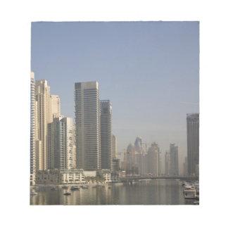 UAE, Dubai. Marina towers with boats at anchor. Notepad