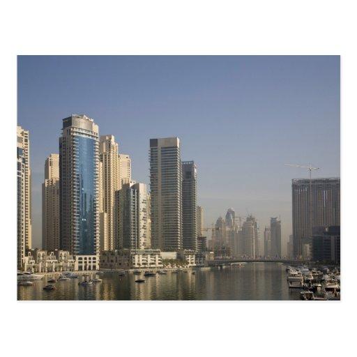UAE, Dubai. Marina towers with boats at anchor. Postcards