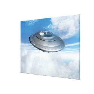 UFO flying through cloudy skies. Canvas Print
