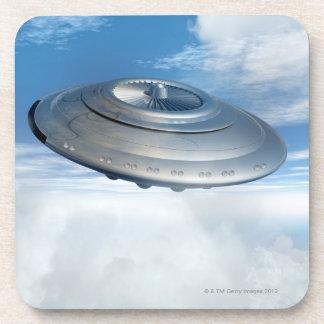 UFO flying through cloudy skies. Coaster