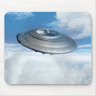 UFO flying through cloudy skies. Mouse Mat