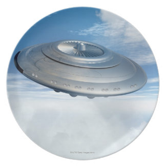 UFO flying through cloudy skies. Plate