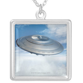 UFO flying through cloudy skies. Silver Plated Necklace