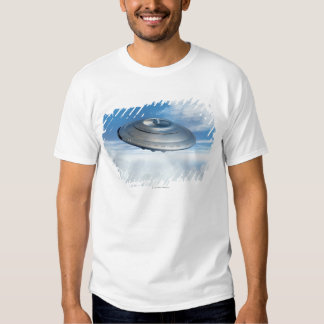 UFO flying through cloudy skies. T-shirt