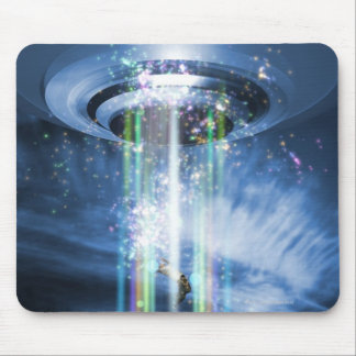 UFO hovering above Earth while abducting humans. Mouse Mat