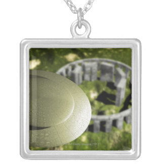 UFO investigating the site of Stonehenge as it Silver Plated Necklace