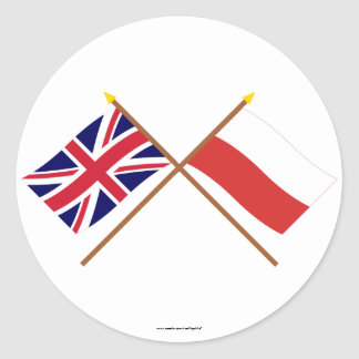 UK and Poland Crossed Flags Classic Round Sticker
