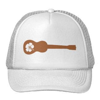 Ukulele and white hibiscus cap
