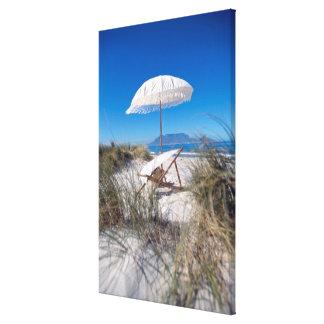 Umbrella And Chair On Beach Canvas Print