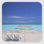 Umbrella and two lounge chairs on beach, Miami