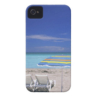 Umbrella and two lounge chairs on beach, Miami iPhone 4 Covers
