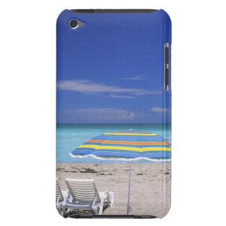 Umbrella and two lounge chairs on beach, Miami iPod Case-Mate Cases