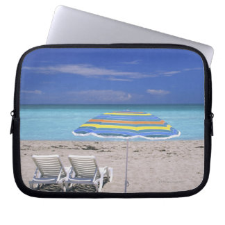 Umbrella and two lounge chairs on beach, Miami Laptop Sleeve