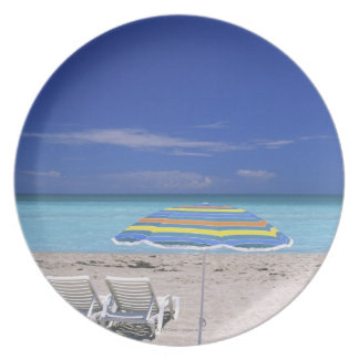 Umbrella and two lounge chairs on beach, Miami Plate