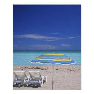 Umbrella and two lounge chairs on beach, Miami Poster